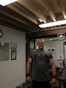 Dave in basement home gym