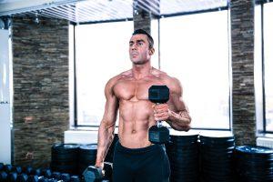 Bodybuilder doing Bicep curl Drop Set